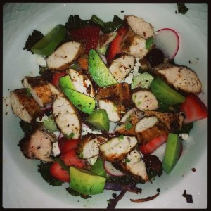 Kale salad with chicken, avocado and strawberries
